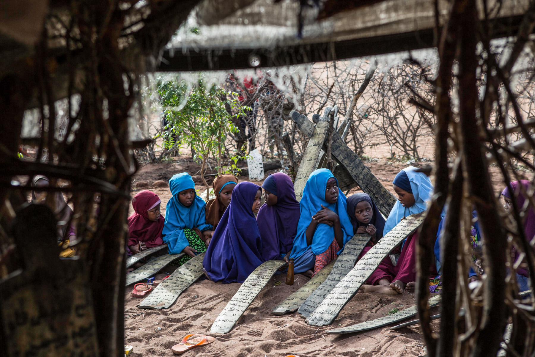 Somali children attend morning madrassa, or Islamic religious classes, in Dadaab refugee camp. They are among hundreds of thousands of Somali refugees who fled violence and starvation, made worse by climate change. Click on the photo to see the story. (Photo by Nichole Sobecki/GroundTruth)