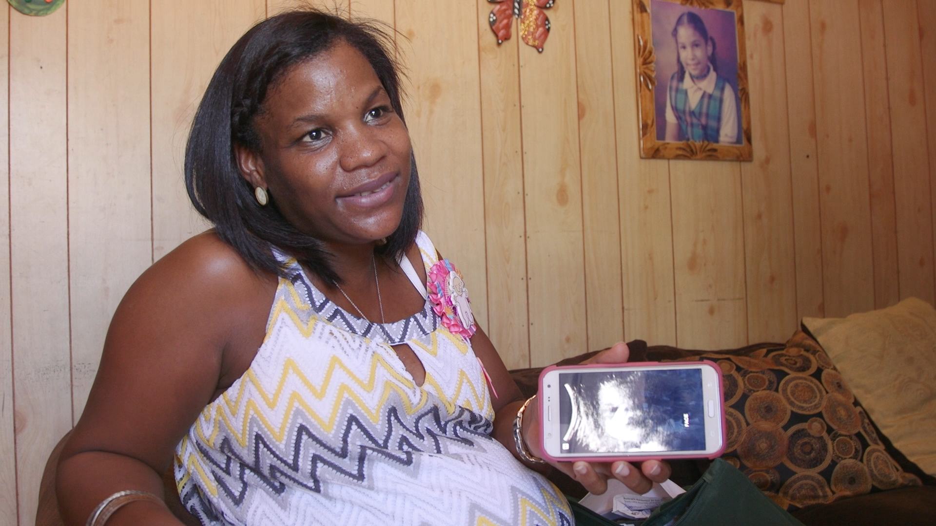 A woman named Adriana shows an image of her expected child, but she's overwhelmed with worries about Zika. Click on the photo to see the whole story. (Photo via GroundTruth Films)