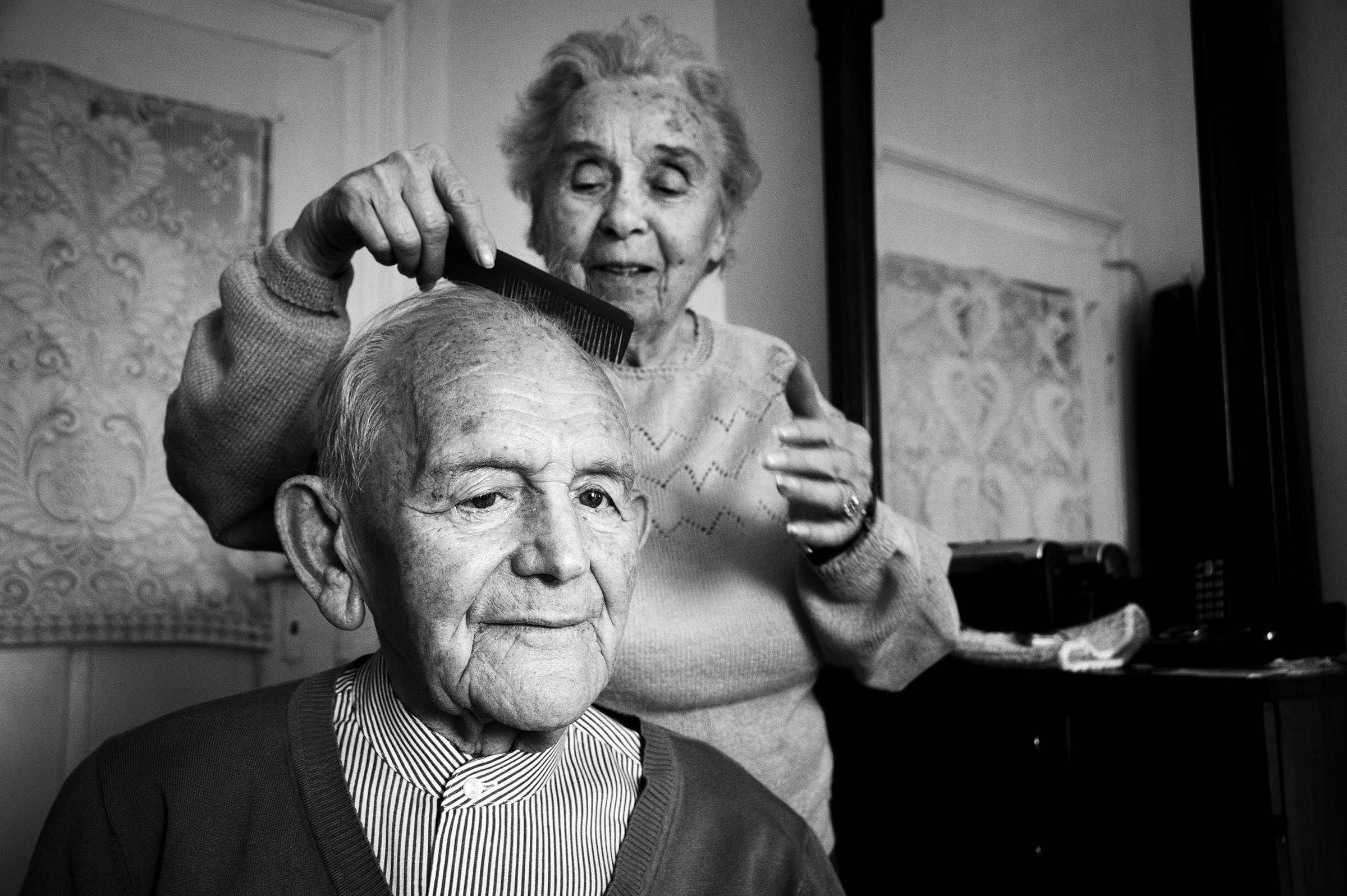 Elisabeta Steuer, 91, cares for her husband Ladislau, 94, at their home in downtown Oradea on January 16, 2015. Both survivors of the Holocaust, Ladislau was deported to a labor camp in Hungary while Elisabeta survived in a ghetto in the Romanian village of Ginta. They have been married for 66 years. (Photo by Daniel Owen/GroundTruth)