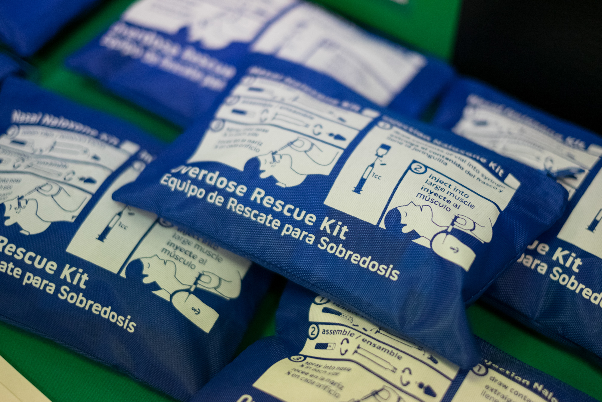 Naloxone rescue kits sit on the table at a drug clinic. (Photo by Edwin Torres/GroundTruth)