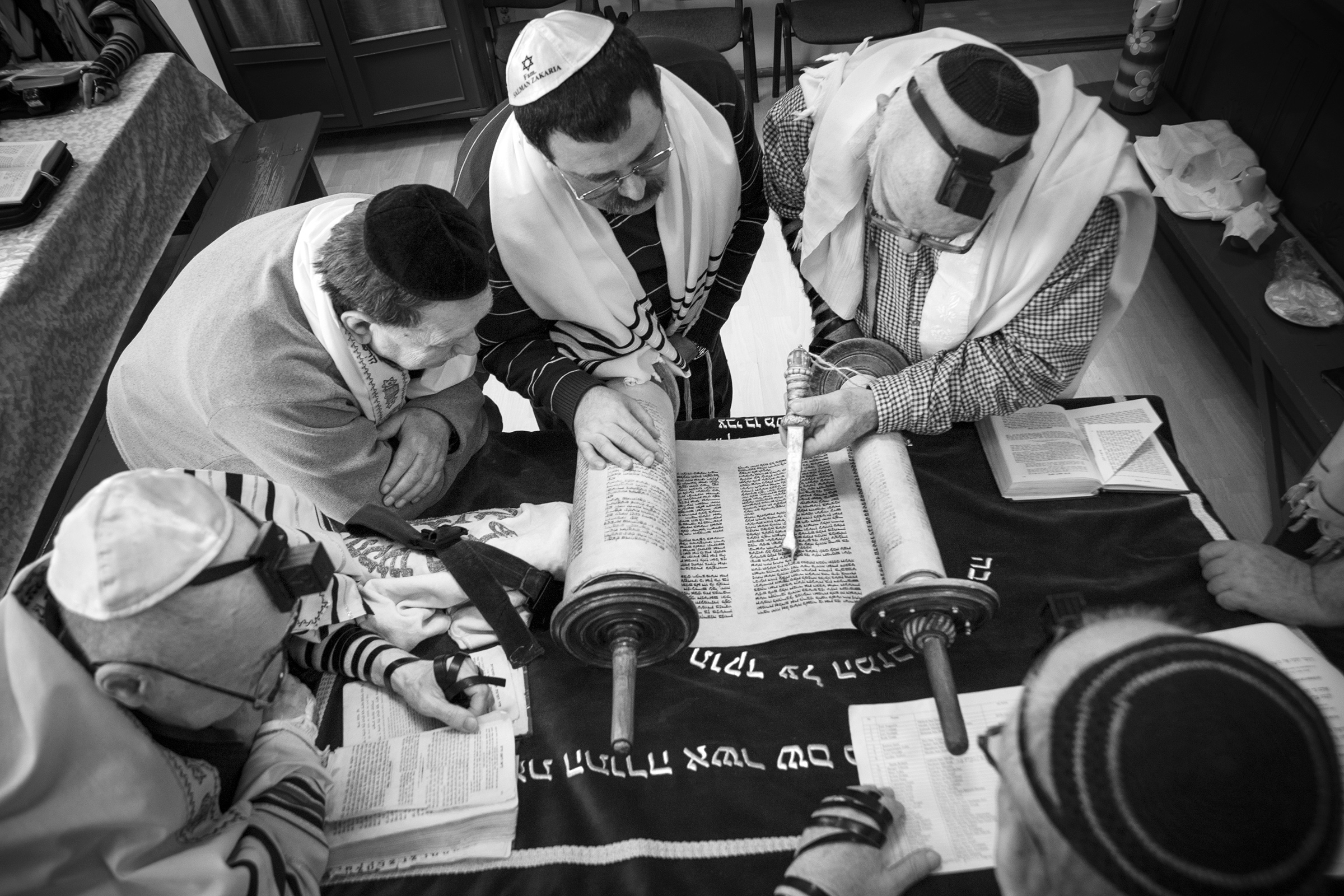 Male members of the Jewish Community Center in Oradea, Romania meet on April 11, 2013, for their weekly reading of the Torah, the Jewish holy book. Though the once thriving community of thirty thousand was devastated by the Holocaust, the few remaining members continue to carry on the ancient Jewish religious traditions. (Photo by Daniel Owen/GroundTruth)