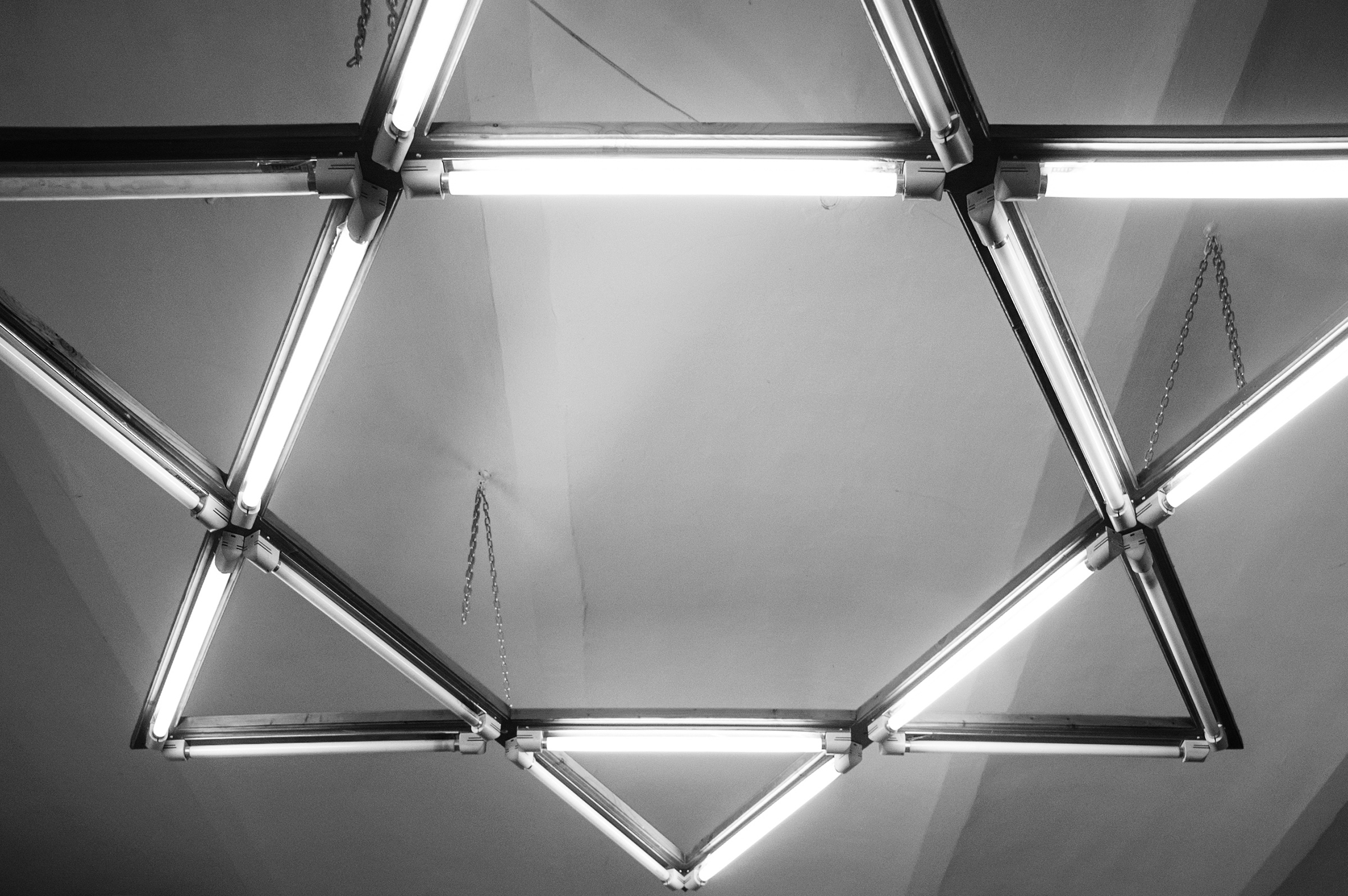 The Star of David-shaped flourescent lights flicker over the small meeting room inside the Jewish Community Center in Oradea, Romania on January 12, 2015. (Photo by Daniel Owen/GroundTruth)