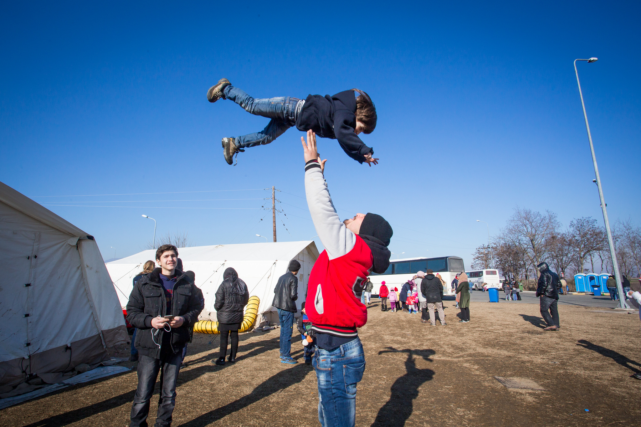 Refugees play at a camp along the Greece-Macedonia border..  (Photo by Natalia Tsoukala and Caritas International/Flickr Creative Commons)