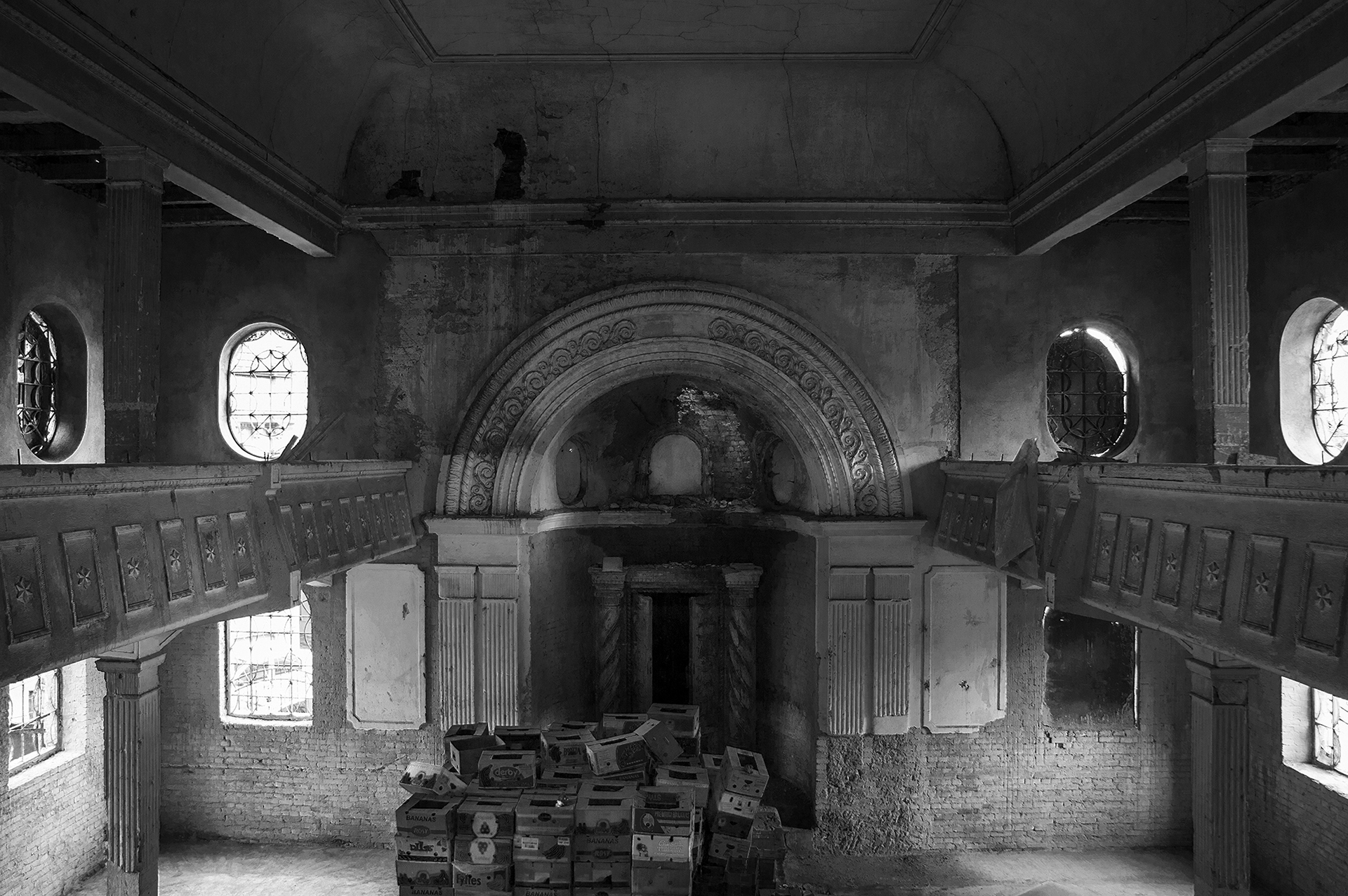 The Teleki Synagogue was the final synagogue built in Oradea in 1928 and was used as a warehouse for the street markets just outside its doors on April 10, 2013. © DANIEL OWEN UPDATE: The once storage room and crumbling synagogue is currently being transformed into a local Jewish history museum. (Photo by Daniel Owen/GroundTruth)