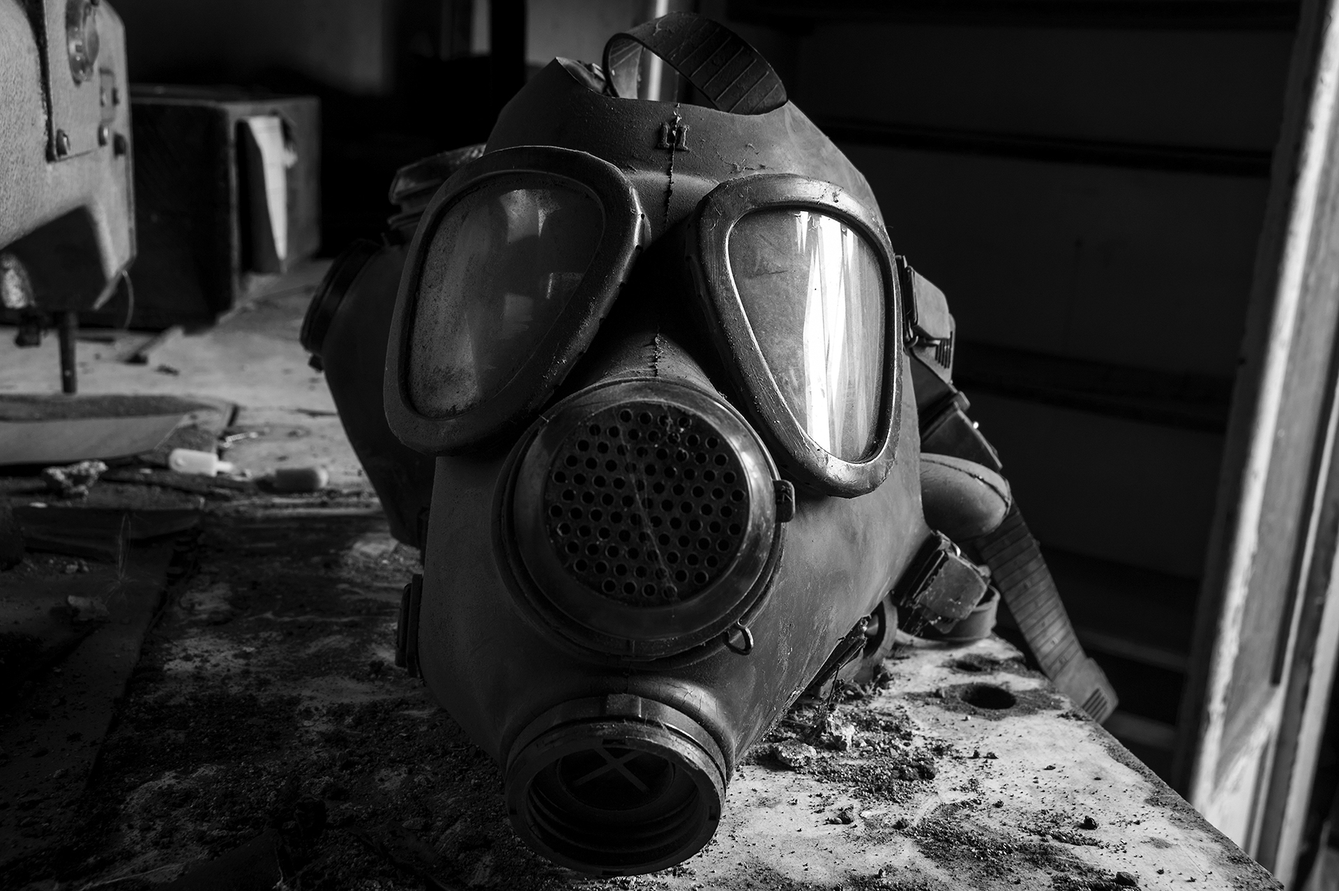 A gas mask sets atop a workbench at an abandoned synagogue-turned furniture shop in Oradea, Romania on August 21, 2013. Though the mask was used only for harsh chemicals during the furniture making process, it is a grim reminder of the uncertain fate of many of the site's former religious members deported during the Second World War. (Photo by Daniel Owen/GroundTruth)