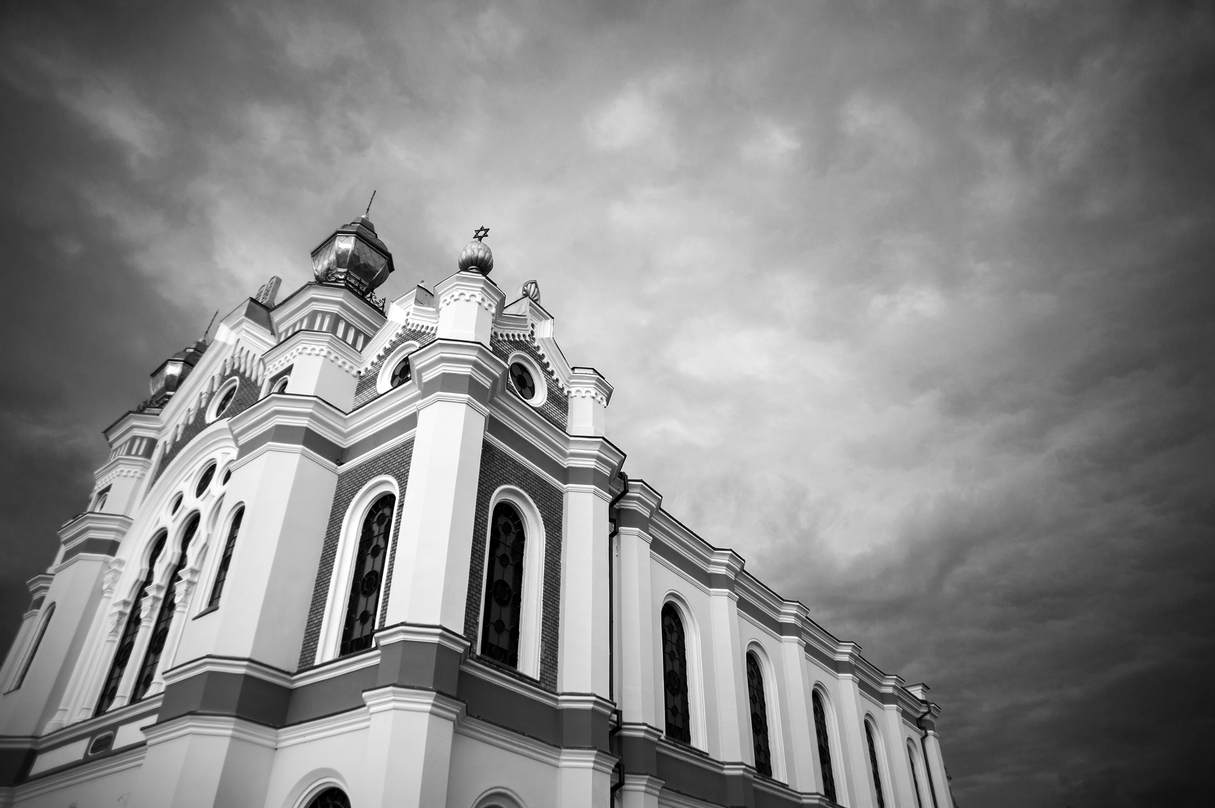 Dark clouds cover the Great Synagogue as a storm rolls in over Oradea, Romania on August 30, 2013. (Photo by Daniel Owen/GroundTruth)