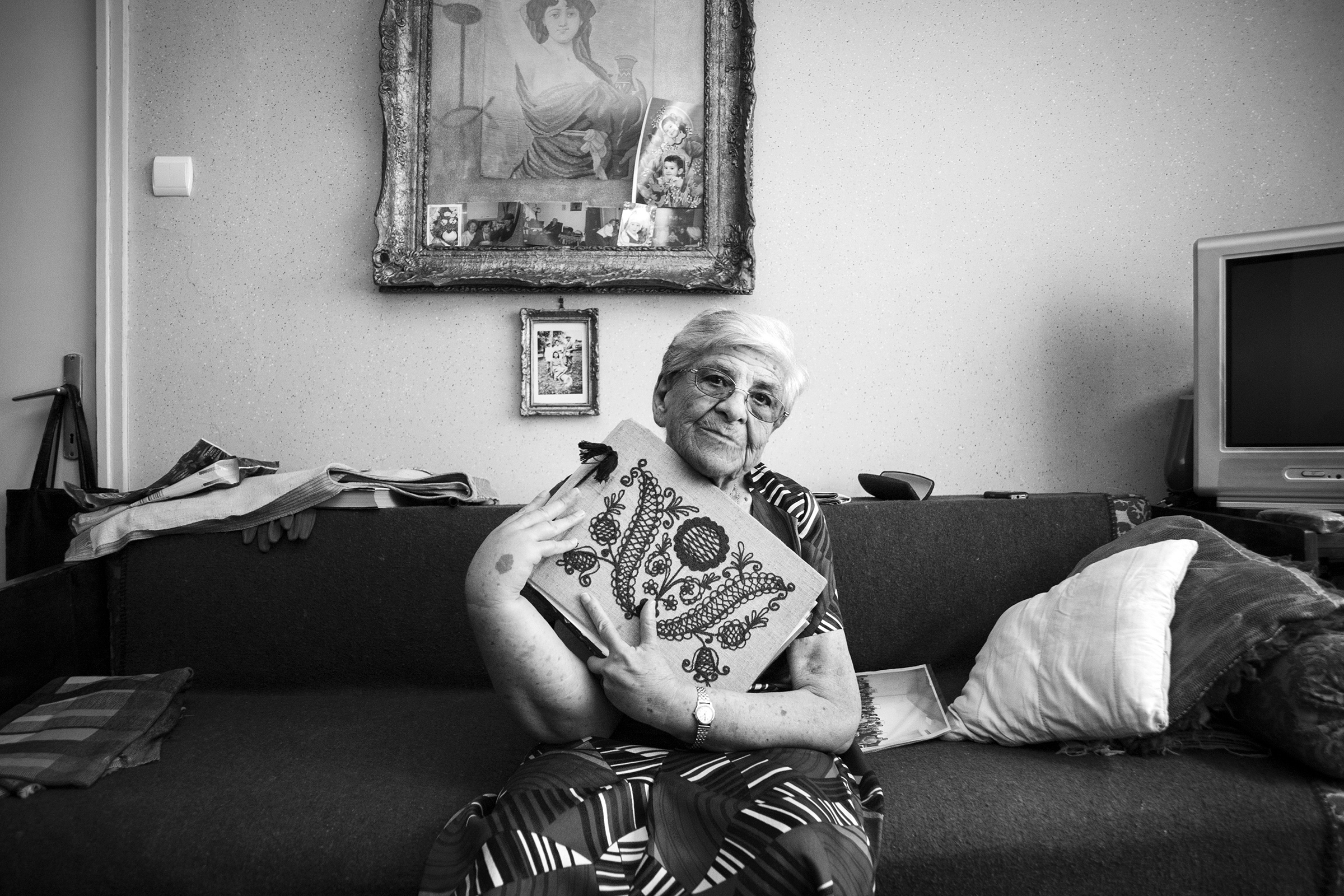"Auschwitz survivor, Iudit Varadi, 87, poses for a portrait with her family photo album at her home in Oradea, Romania on August 18, 2013. ""My brother and mother died in the camps. Altogether, I lost around eighty members of my extended family in the Holocaust, so when I returned home I was alone. I had to start my life all over."" Mrs. Varadi passed away shortly after her portrait. (Photo by Daniel Owen/GroundTruth)"