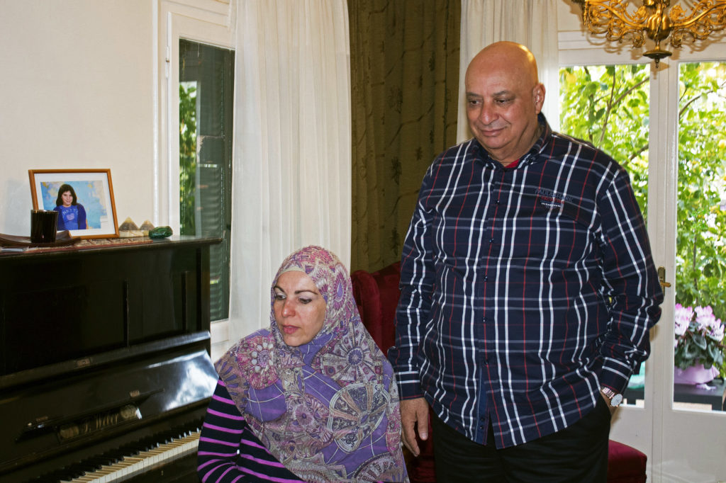 Naim El-Ghandour, activist and president of the Muslim Association of Greece, stands with his wife, Anna, in his home in Athens, Greece. About two weeks ago, he testified against Golden Dawn.  (Photo by Marie Targonski-O'Brien/GroundTruth)