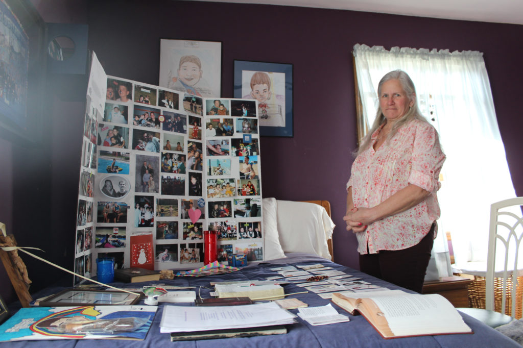 Candace Crupi stands in the room of her son, Johnny Crupi, who died of a heroin overdose at the age of 21. (Photo by Noah Caldwell/GroundTruth)