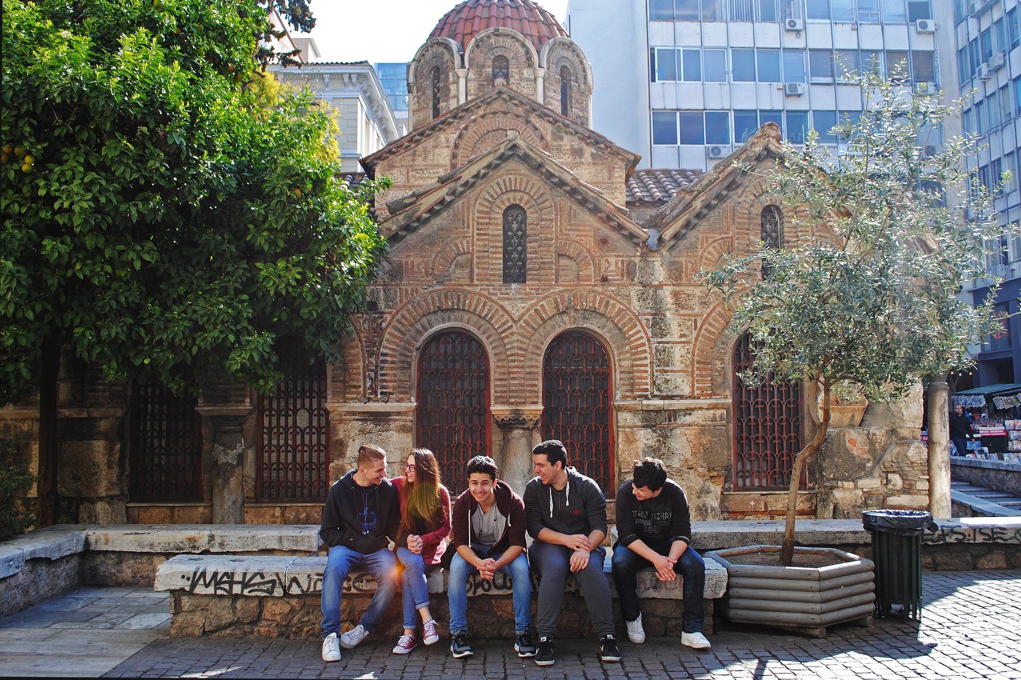 Greek youth gather outside a church in Athens. Secularization has caused more youth to spend their time outside the walls of the churches — despite religion playing a key factor in Greece's history and nationalism. (Jolene Latimer/GroundTruth)