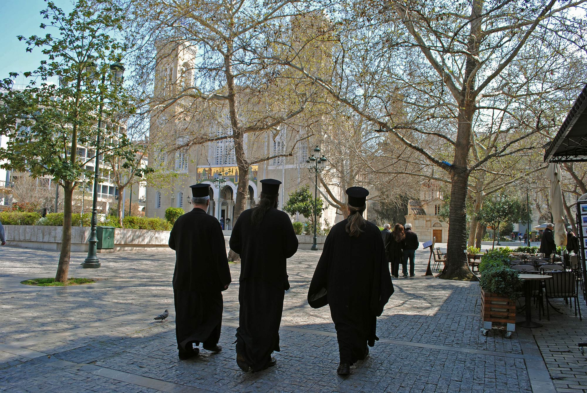 Greek Orthodox clergy walk through the streets of Athens. (Photo byJolene Latimer/GroundTruth)