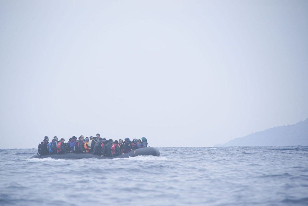 Refugees cross the Mediterranean sea on a boat in January 2016, heading from Turkish coast to Greece. (Photo via Wikimedia Commons)