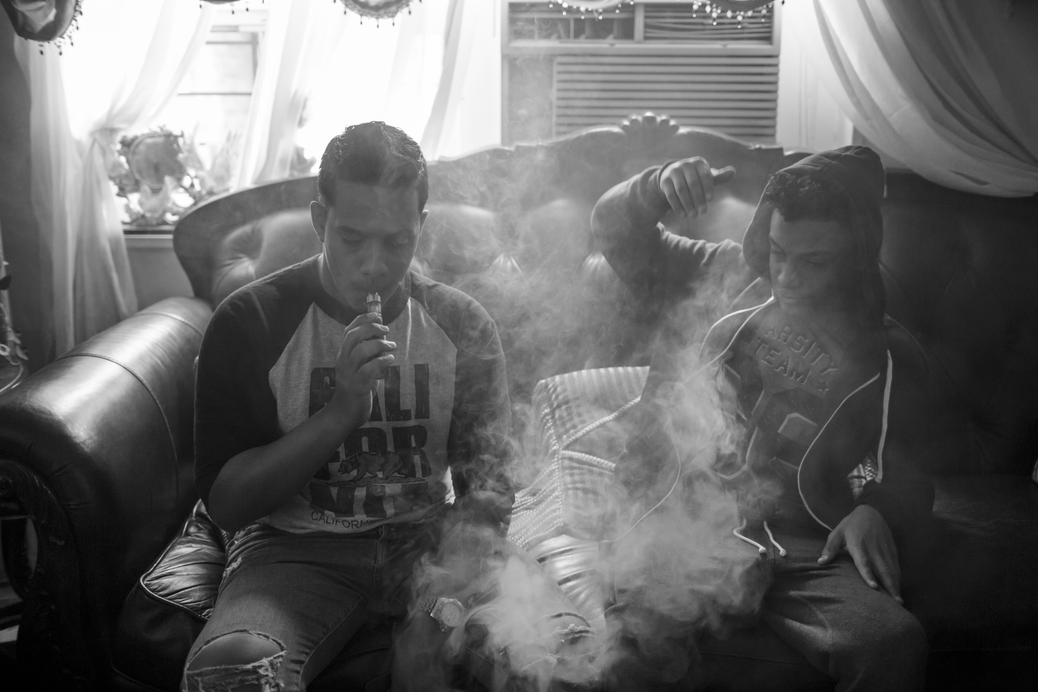 Chavier Leon vapes with his older brother in the living room of their apartment, May 14, 2016, Patterson Projects, Mott Haven, South Bronx. (Photo by Sarah Blesener/GroundTruth/Alexia Foundation)