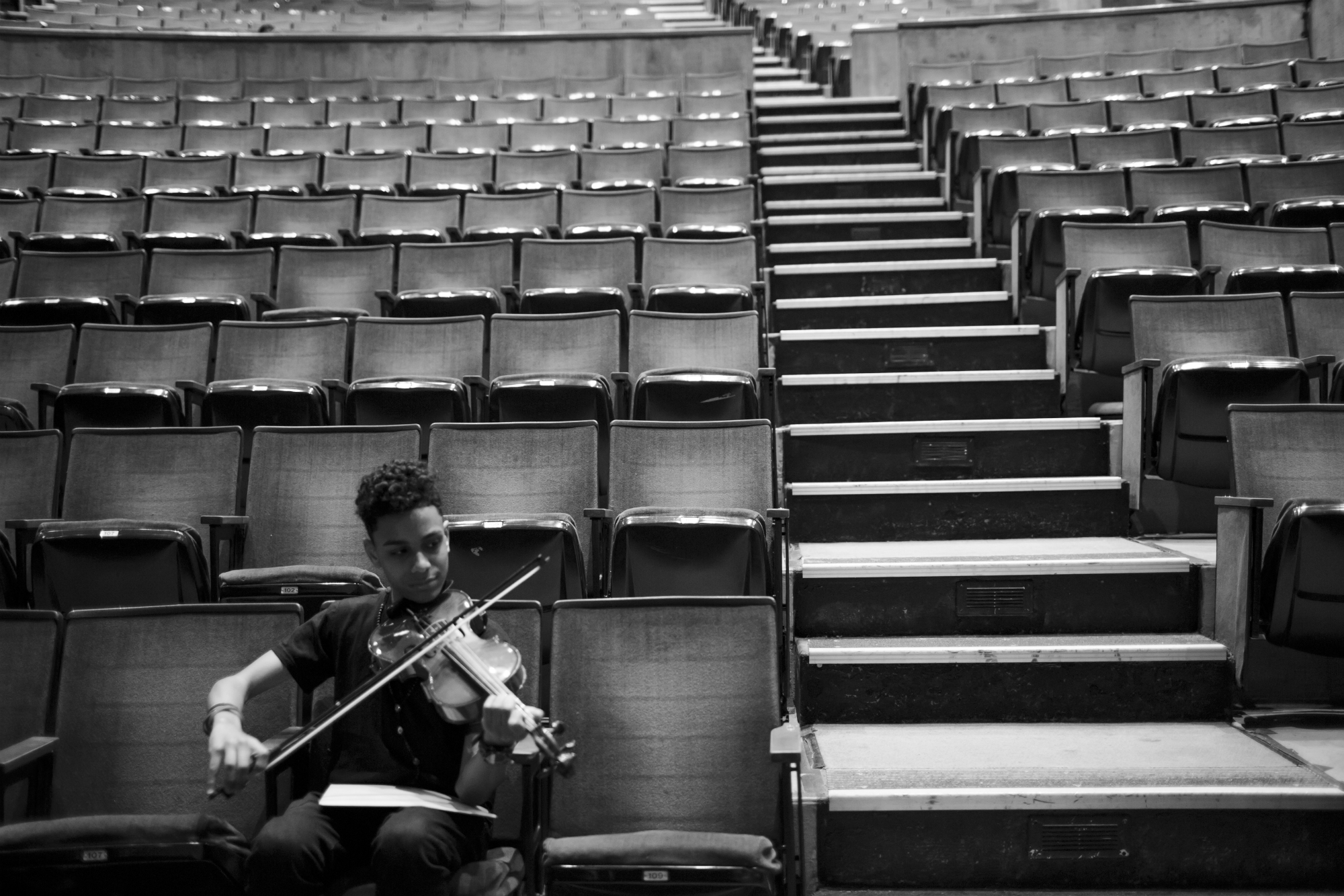 Chavi Leon practices violin before a concert, directed by Professor Kim Cai, at the High School of Violin and Dance, May 12, 2016, Lehman College, Bronx, New York. Following practice, the students will perform their year-end concert for the public. (Photo by Sarah Blesener/GroundTruth/Alexia Foundation)