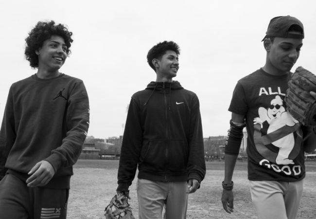 Edwin, Chavi, and Steven practice baseball in front of Yankee Stadium, March 26, 2017, Bronx, New York. The friends meet once a week to practice at the fields together. (Photo by Sarah Blesener/GroundTruth/Alexia Foundation)