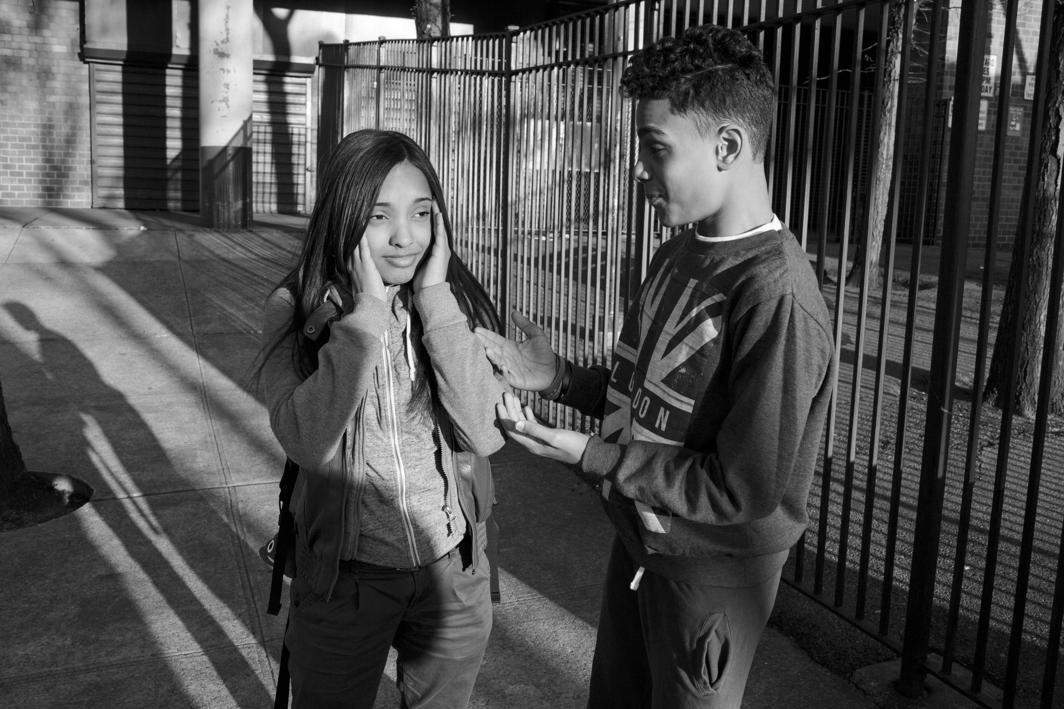 Chavi Leon talks with his neighbor and classmate after school on April 14, 2016, South Bronx, New York. (Photo by Sarah Blesener/GroundTruth/Alexia Foundation)