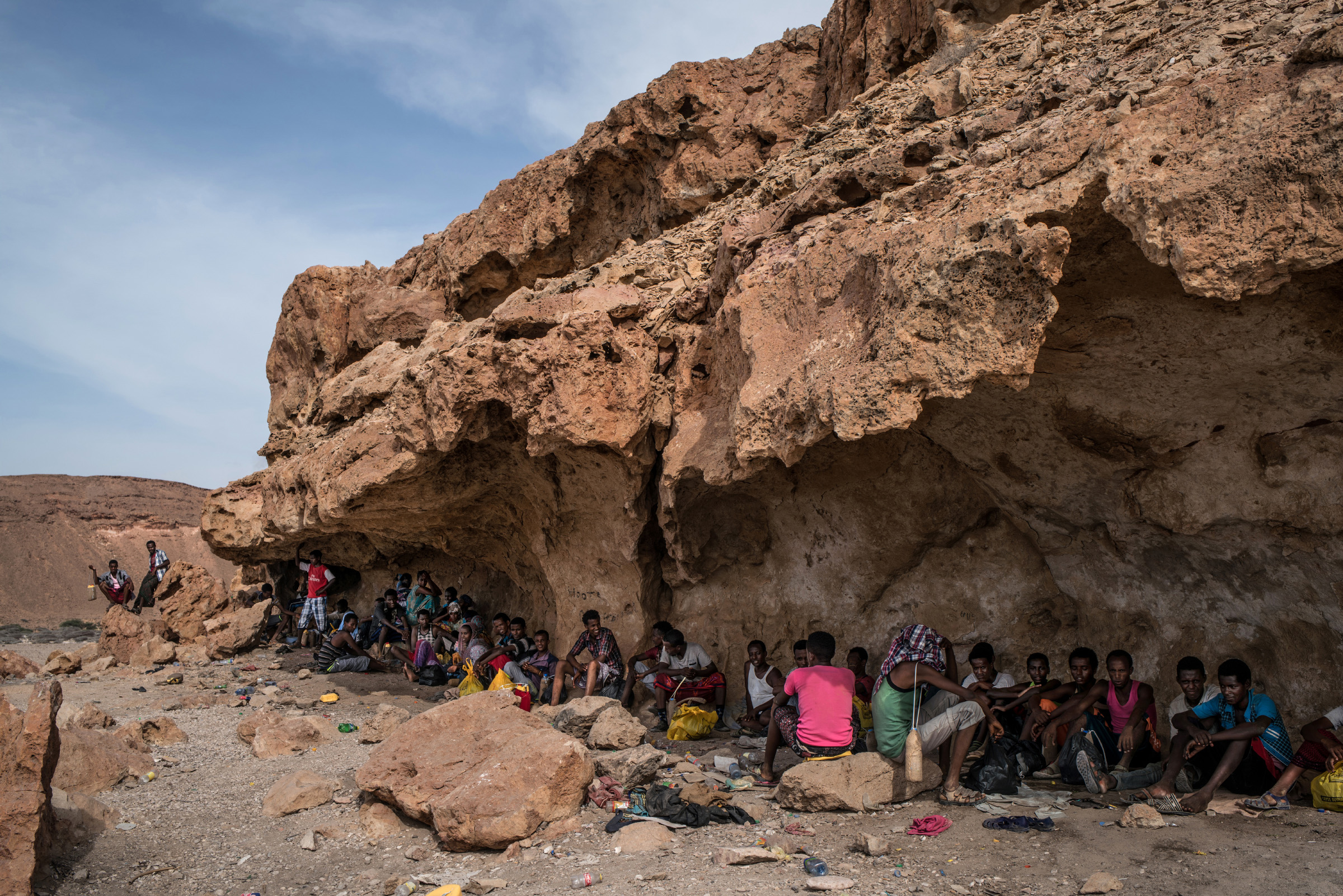 In Mareero, a smuggling hub in the semi-autonomous region of Puntland, Somali and Ethiopian migrants crowd into caves to wait for the dhow boats that will carry them on the perilous journey across the Gulf of Aden to Yemen. (Photo by Nichole Sobecki/GroundTruth)