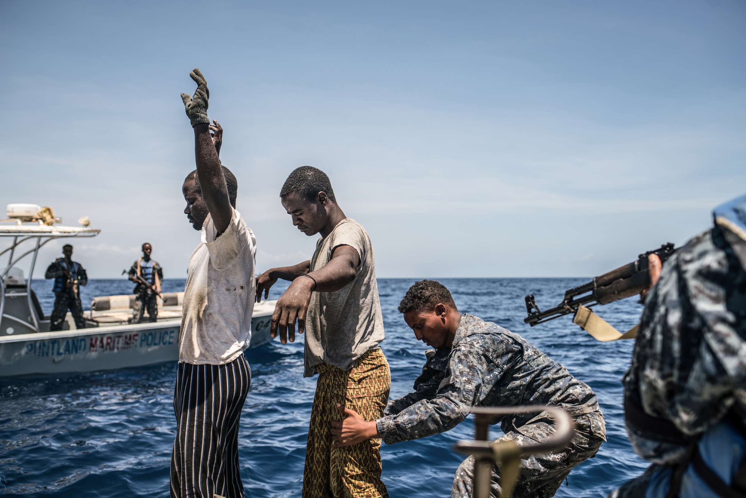 The Puntland Maritime Police Force searches a fishing boat for arms while on patrol off the coast of Bosasso. (Photo by Nichole Sobecki/GroundTruth)