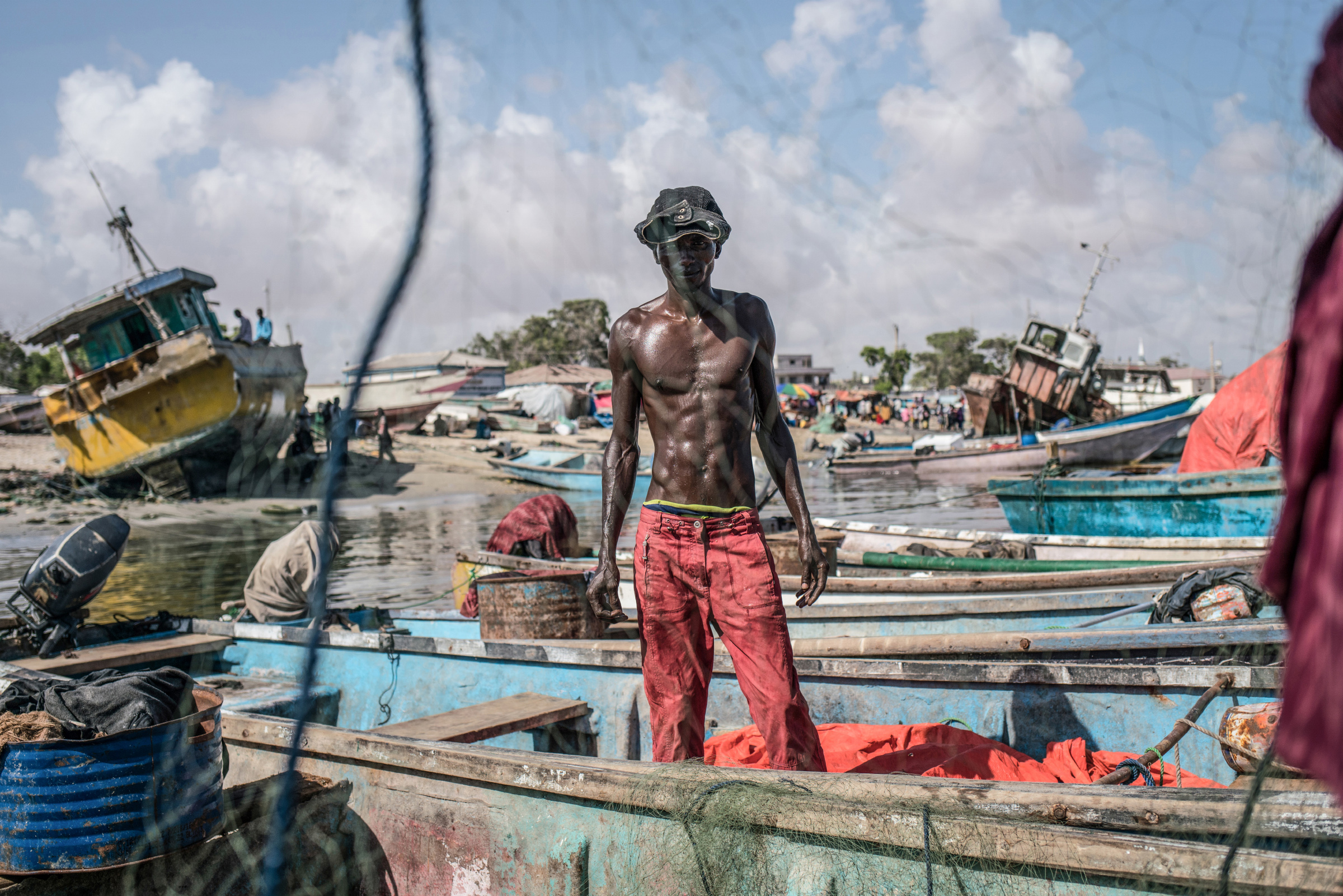 Fishermen untangle their nets in the port of Bosaso, the largest city in Puntland. (Photo by Nichole Sobecki/GroundTruth)