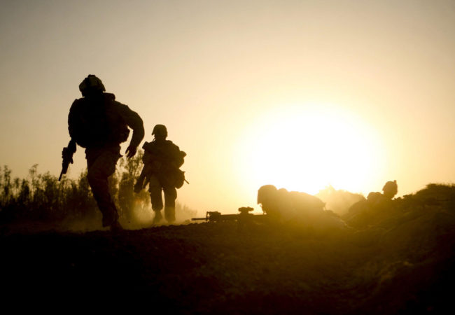 Marines with Company B, 1st Battalion, 5th Marine Regiment, Regimental Combat Team 3, run for cover during a fire fight in Nawa District, Helmand province, Afghanistan, Oct. 2, 2009. Dave Philipps covers veterans issues, and found out about suicidal veterans who had served in Afghanistan through a social media group they used. (Lance Cpl. John McCall via ISAF Public Affairs/Flickr Creative Commons)
