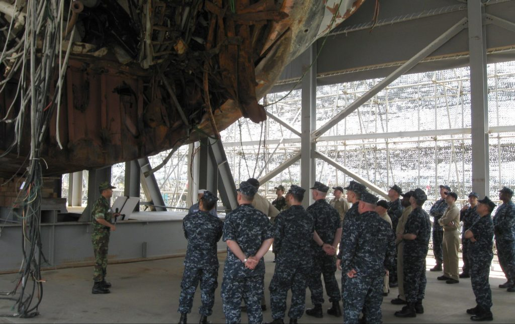Sailors from USS George Washington (CVN 73) and Carrier Task Force (CTF) 70  along with South Korean service members attend a debriefing on the wreckage of South Korea's Cheonan ship, which was allegedly destroyed by a North Korean torpedo in 2010, killing 46 people.  (Official U.S. Navy photo)