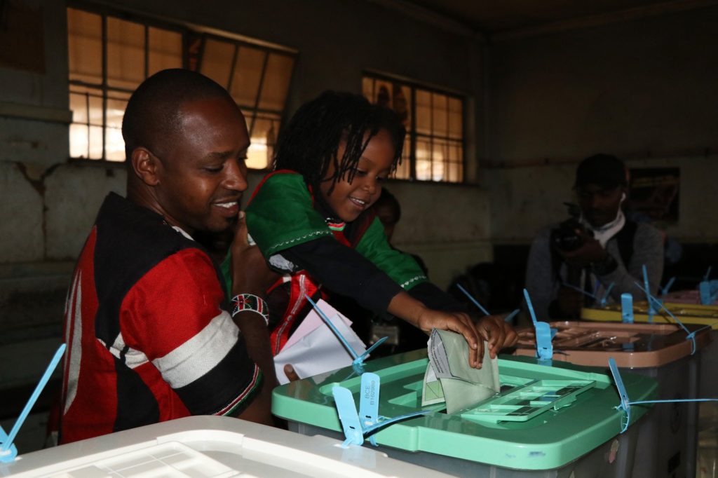 Boniface Mwangi, a 34-year-old journalist turned activist ran for Parliament. He cast his vote with his family at Juja Road Primary School in Nairobi, Kenya on August 8, 2017. (Neha Wadekar/GroundTruth)