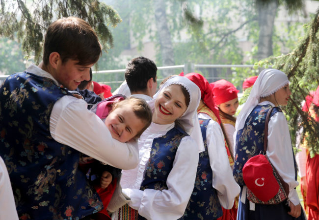Dancers in national costumes wait in the wings to perform for E.U. Day. Moldovans find their country in a tug of war between Russia and the E.U. (Carolyn Cakir/Medill/GroundTruth)
