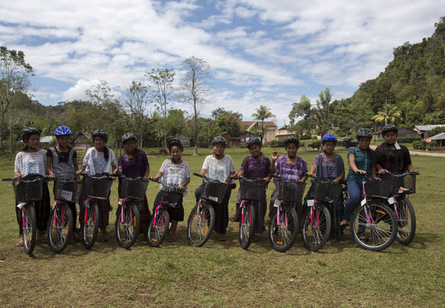 Girls in Chisec, Guatemala, receive bicycles from an initiative started by GroundTruth's Lauren Bohn, SchoolCycle. Bicycles allow girls to more easily travel to school, and give them autonomy over their own movement. (Lauren Bohn/GroundTruth)