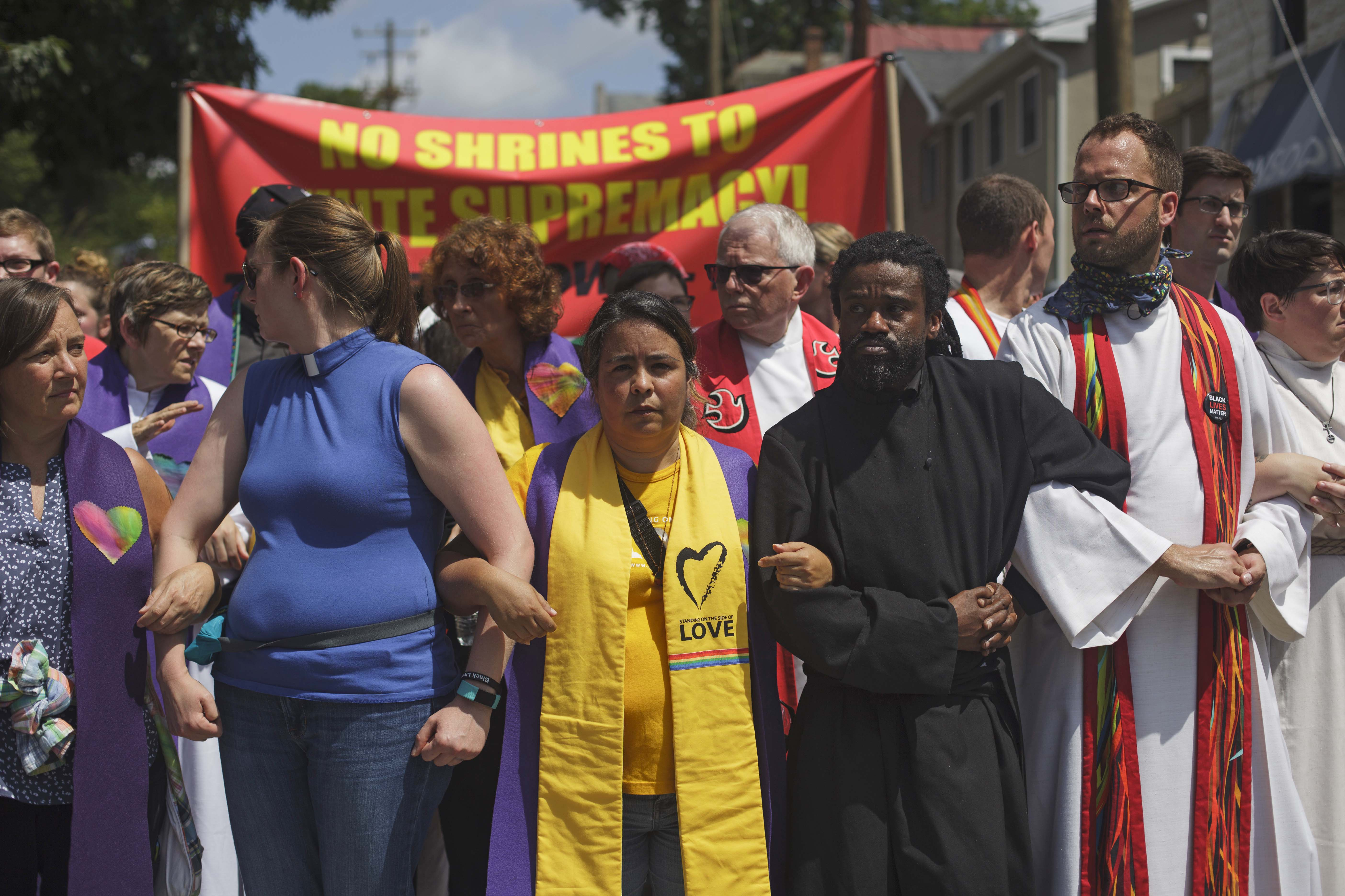 A interfaith group of clergy locked arms on the outskirts of the Unite The Right rally to stand in opposition of white supremacy. August  12, 2017, Charlottesville, VA. (Shay Horse/GroundTruth)