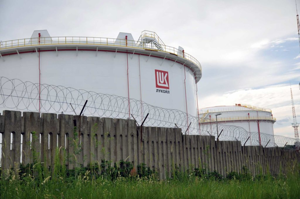 Fences topped by barbed wire surround oil storage tanks at the Lukoil port facility in Burgas. (David Jordan/Medill/GroundTruth)