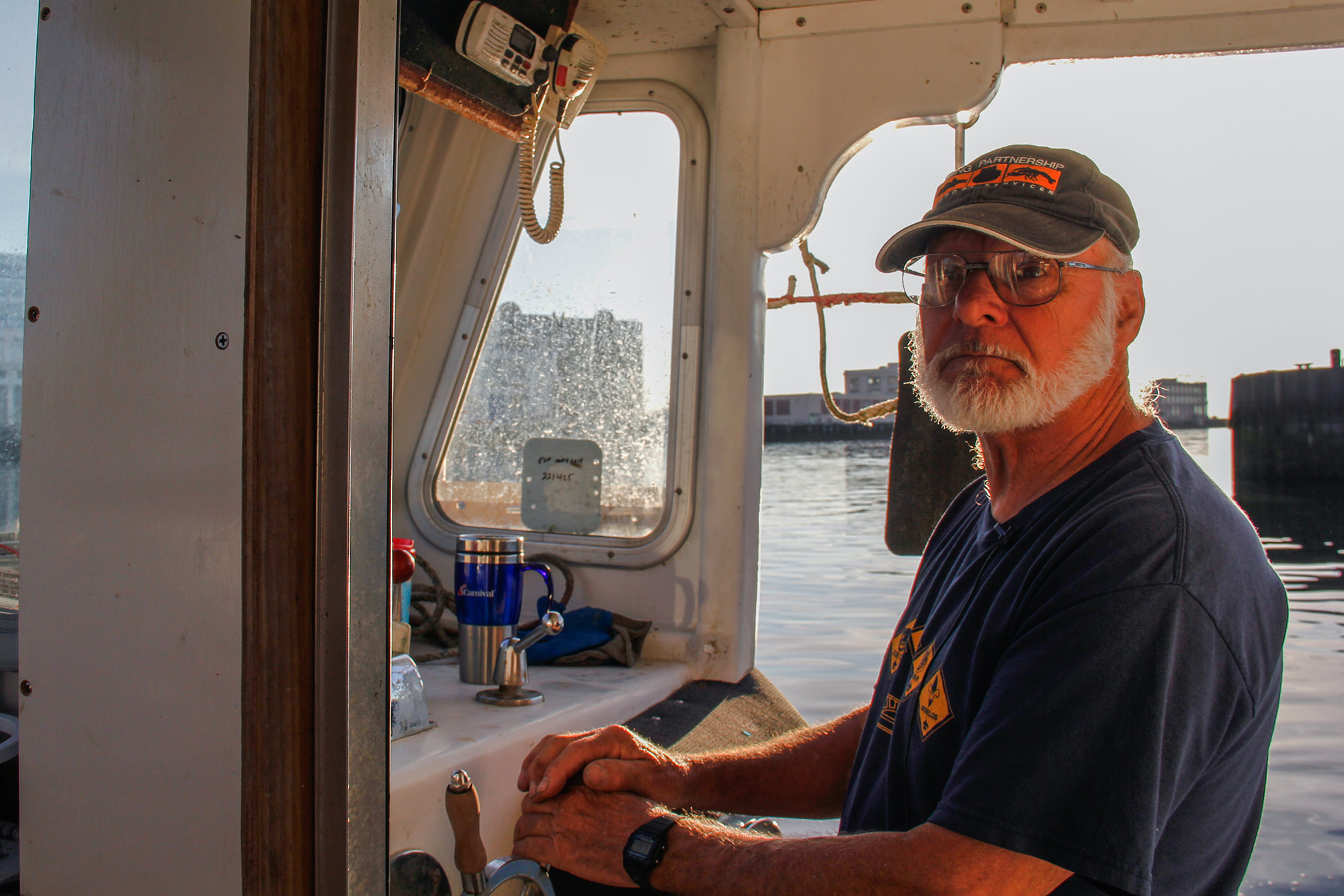 Captain Fred Penney, aboard his lobsterboat, The Sixpence. Captain Penney starts his day before dawn. (Ellen Kazinger/GroundTruth)
