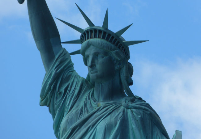 The Trump administration's proposed RAISE Act, to limit immigration, defies the spirit of the Emma Lazarus poem inscribed on the Statue of Liberty, writes Kevin Grant. (Alex.m.Hayward/Flickr)