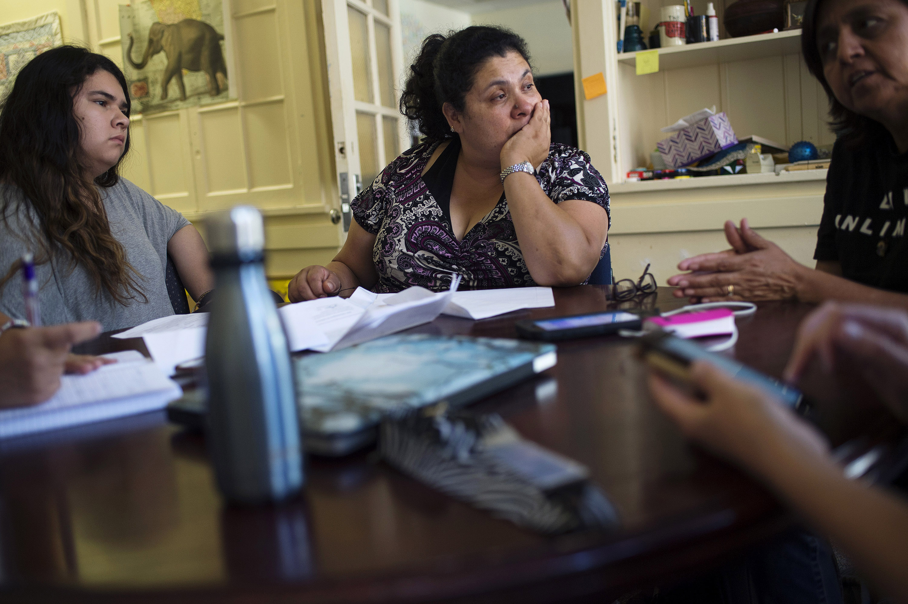 Lourdes Quintana-Salazar, 15, her mother Lourdes Salazar Bautista, and family friend Leonor Kromis, of Ann Arbor,