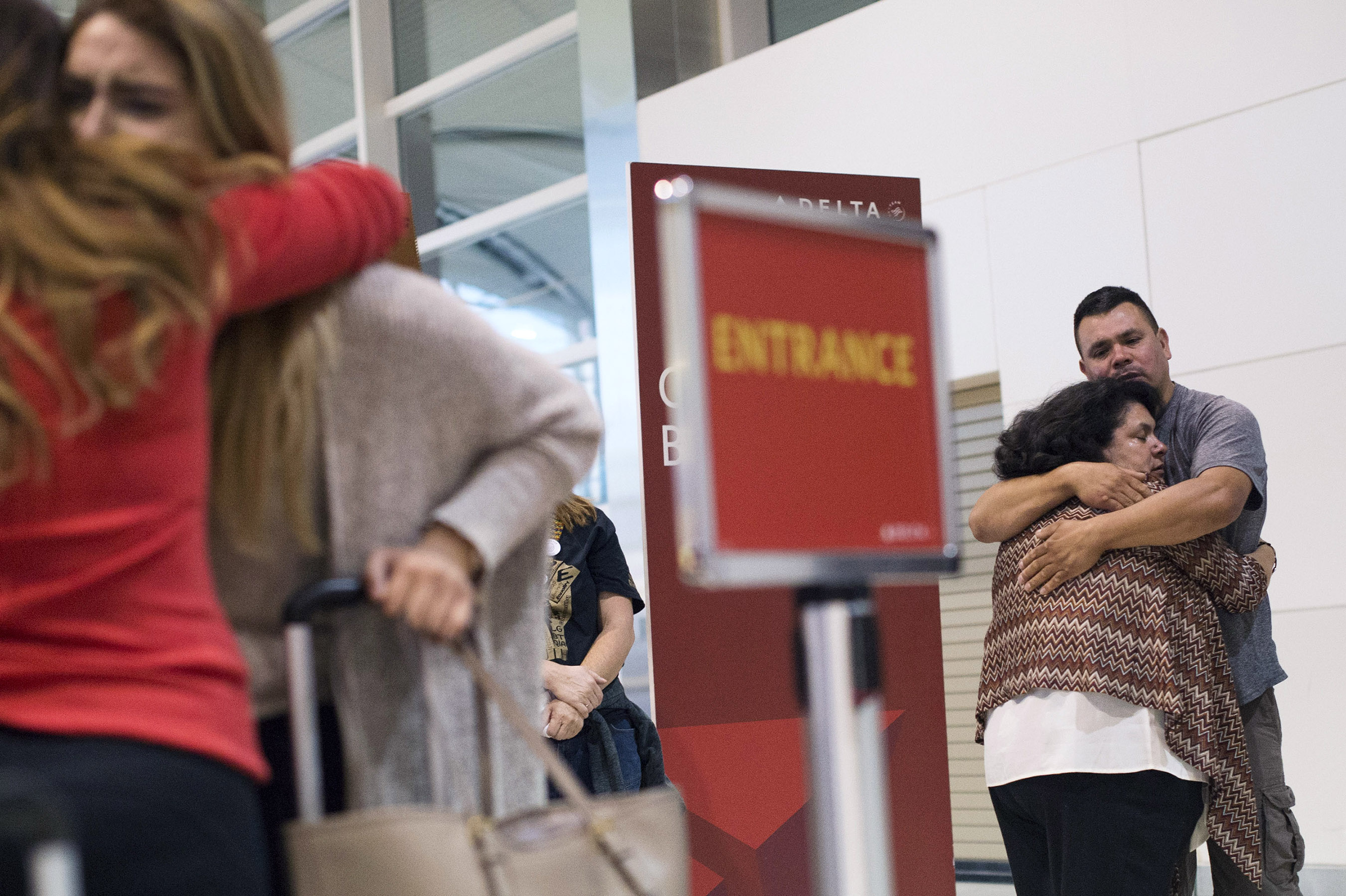Pamela Quintana-Salazar, 19, hugged a loved one goodbye as her mother, Lourdes Salazar Bautista, hugs her brother, Pedro Salazar