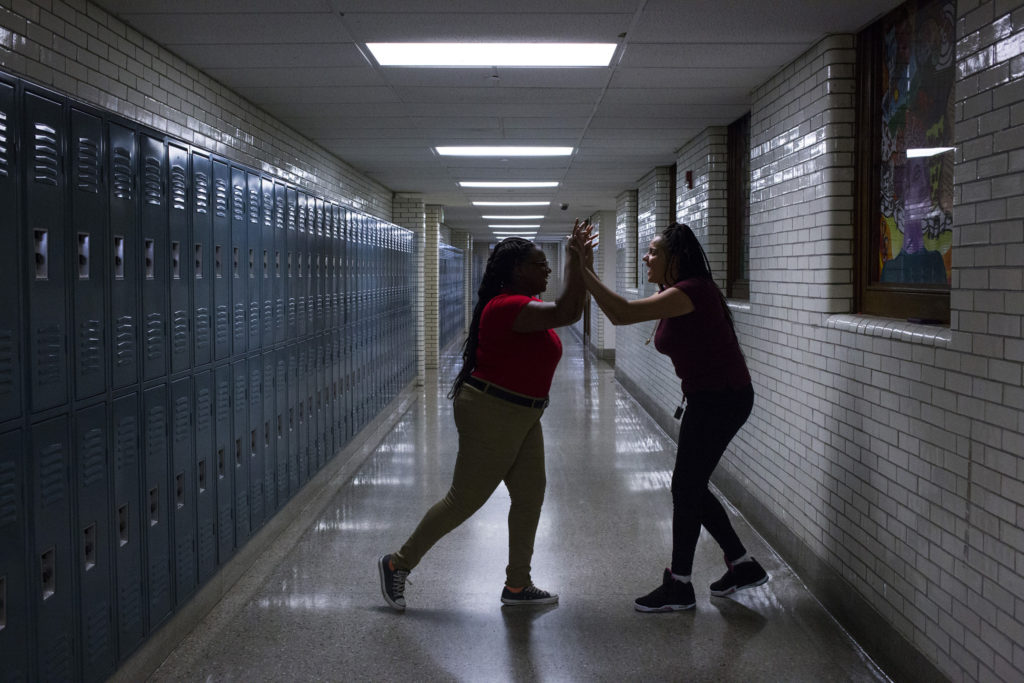 Tre'ana Taylor, 17, celebrates a successful step with a student she was teaching a step routine for JROTC at the High School of Commerce in Springfield, Mass., on Monday, September, 11, 2017. (Photo by Brittany Greeson)