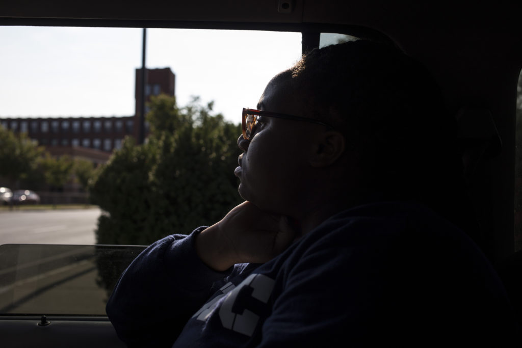 Tre'ana Taylor, 17, gazes at the cityscape out the window of a friend's car on her way home from school in Springfield, Mass., on Monday, September, 11, 2017. (Photo by Brittany Greeson)