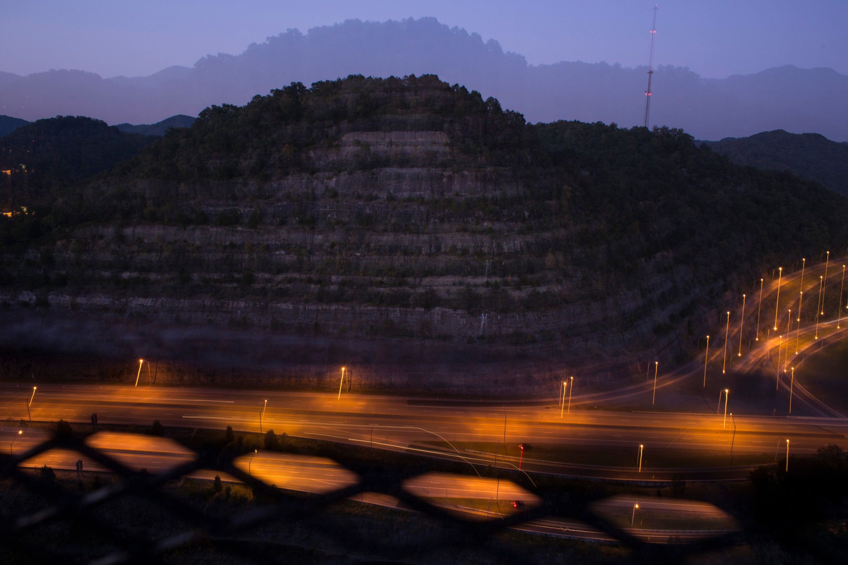 Layers of rock are seen towering above a busy highway just outside of Pikeville, Ky., on Saturday, September, 29, 2017. (Photo by Brittany Greeson/GroundTruth)