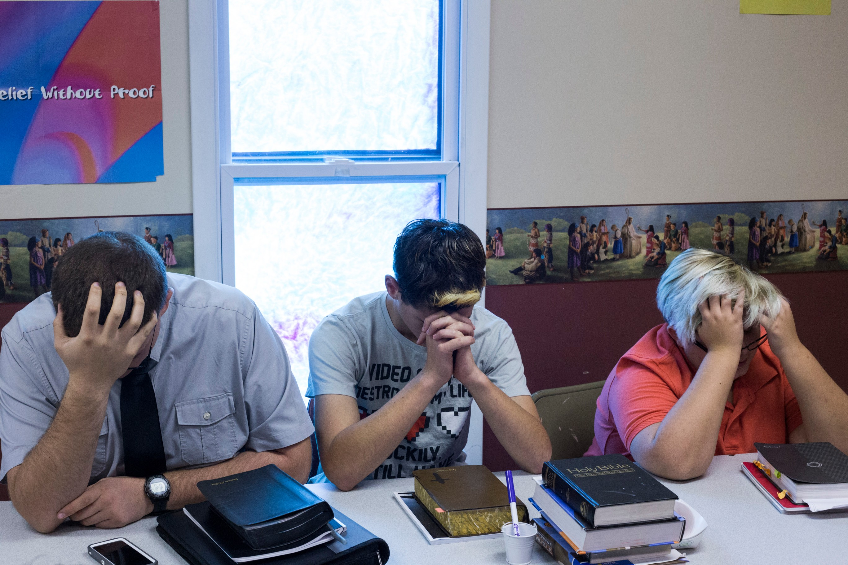 Students bow their heads to pray during Sunday school at the First Baptist Church in McDowell, Ky., on Sunday, September 24, 2017. (Photo by Brittany Greeson/GroundTruth)