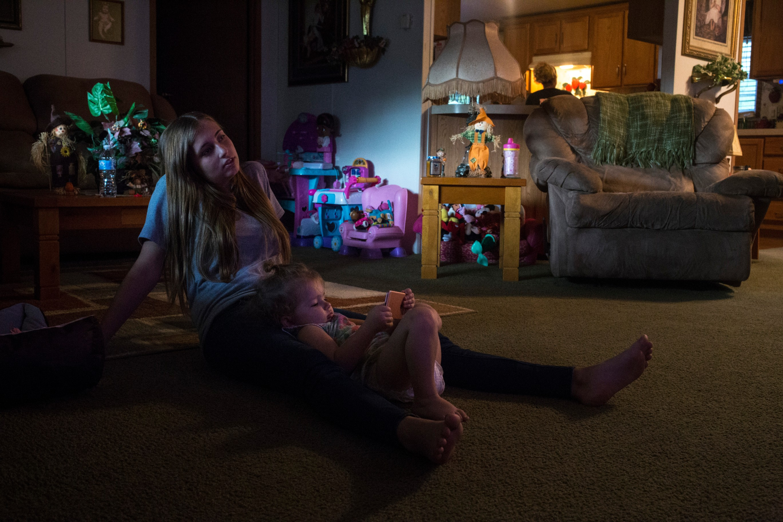 "Haley Jarvis, 17, watches ""Sing,"" a children's movie, with her daughter Paisley, 2, at her boyfriend's home in Langley, Ky., on Tuesday, September 26, 2017. (Photo by Brittany Greeson/GroundTruth)"