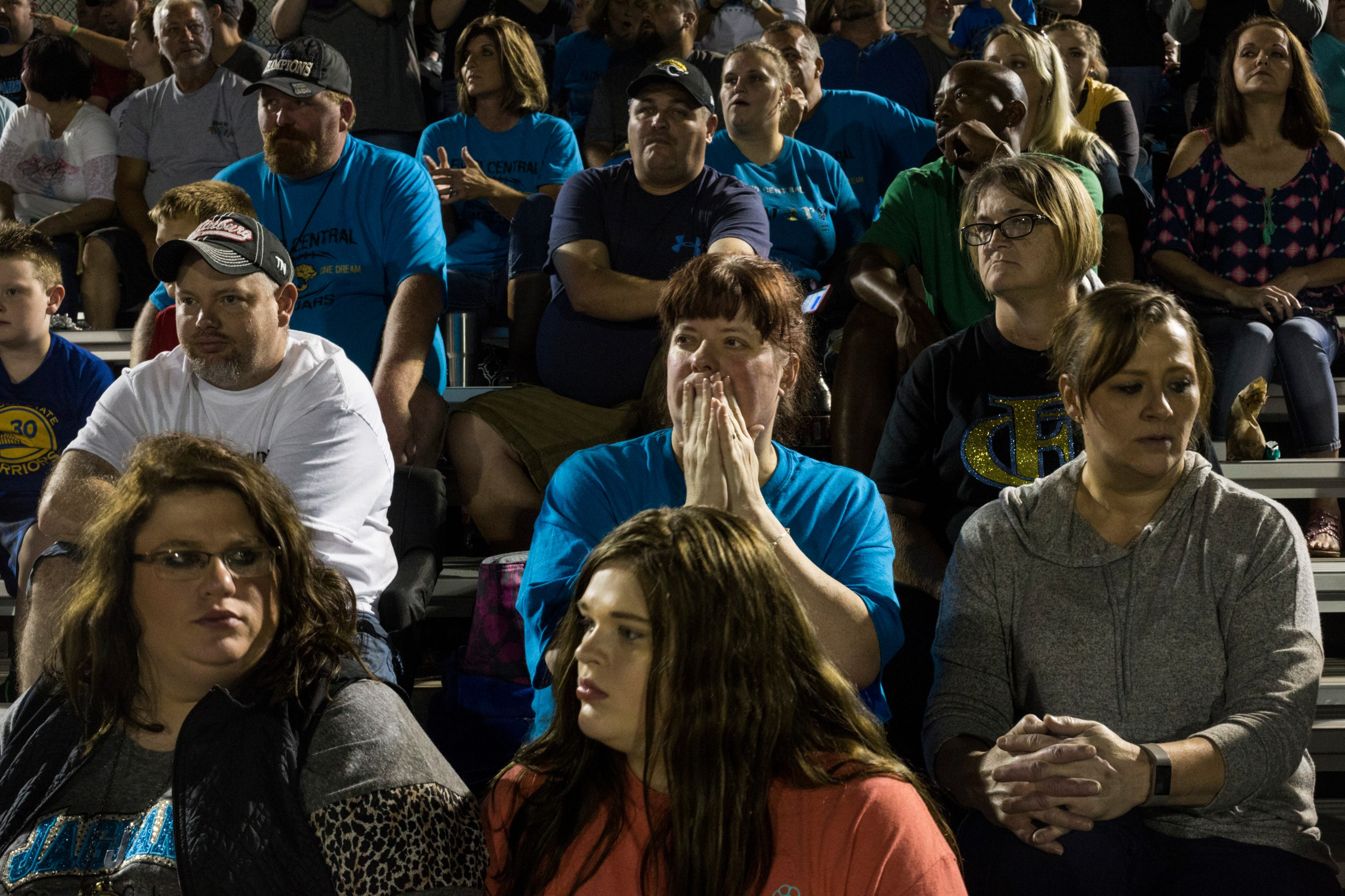 Angie Heard Minnie, center, watches intently as a play is made during a close football game at Floyd Central High School in Langley, Ky., on Friday, September 22, 2017. (Photo by Brittany Greeson/GroundTruth)