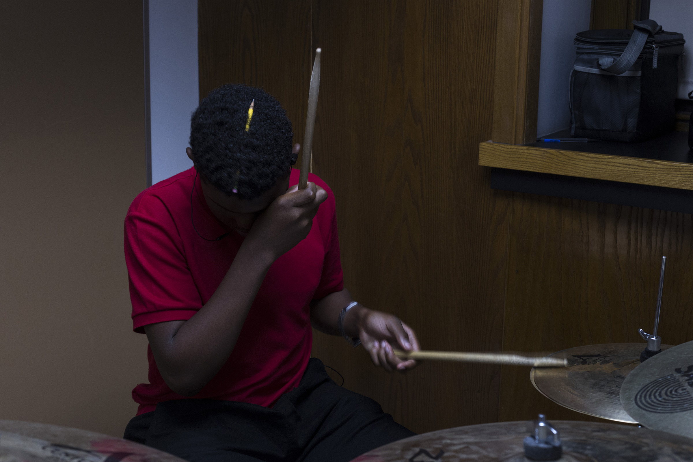 Holding a pencil in his hair, a student plays the drums in sequence with his classmates during jazz band at the High School of Commerce in Springfield, Mass., on Monday, September, 11, 2017. (Photo by Brittany Greeson)