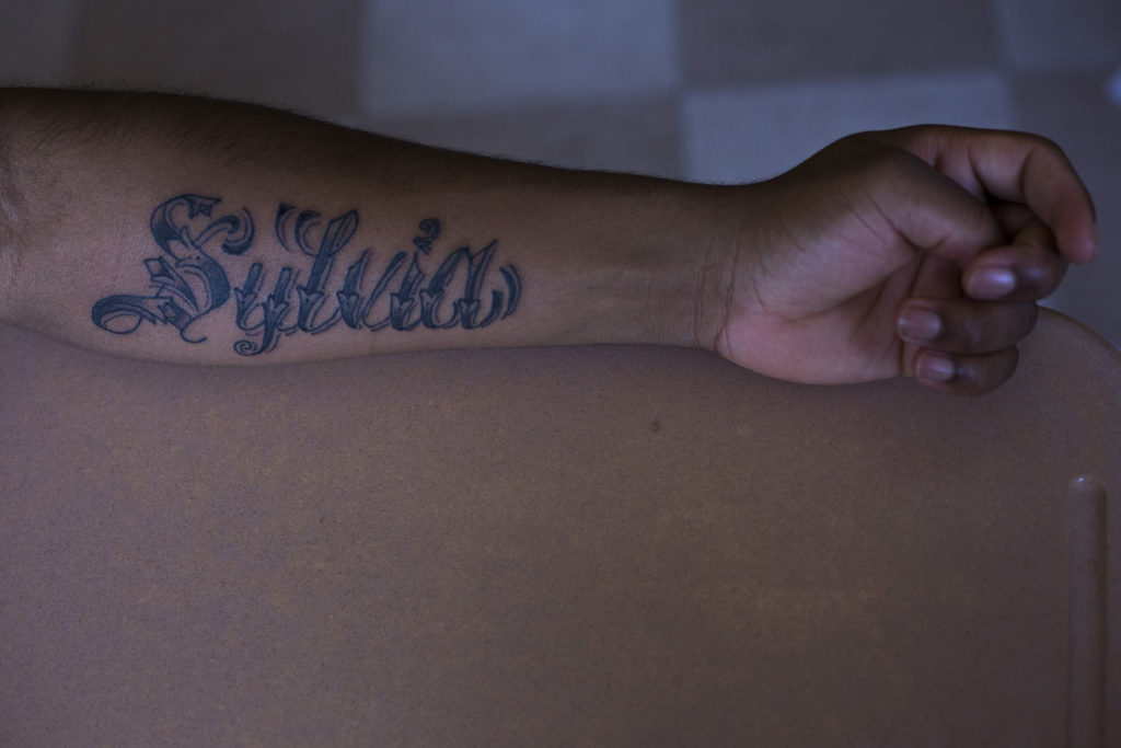 "Vdremus Covington, 18, shows his new tattoo dedicated to his mother during his journalism class at the High School of Commerce in Springfield, Mass., on Monday, September, 11, 2017. ""She's always looking out for me ... she'll be there for me when I need her to,"" Covington said. (Photo by Brittany Greeson)"