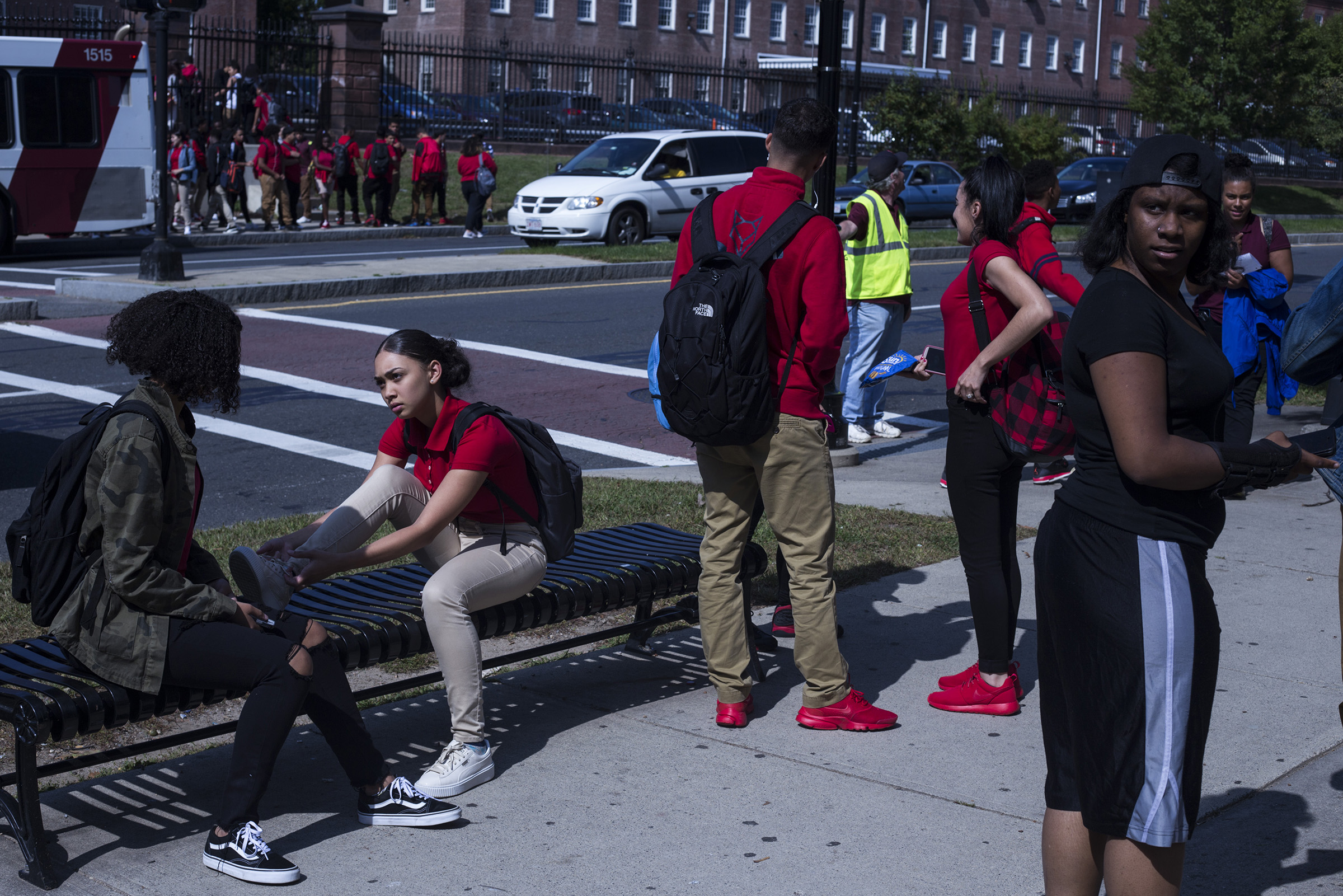 Students wait for transportation in front of the High School of Commerce following their school day in Springfield, Mass., on Monday, September, 11, 2017. (Photo by Brittany Greeson)