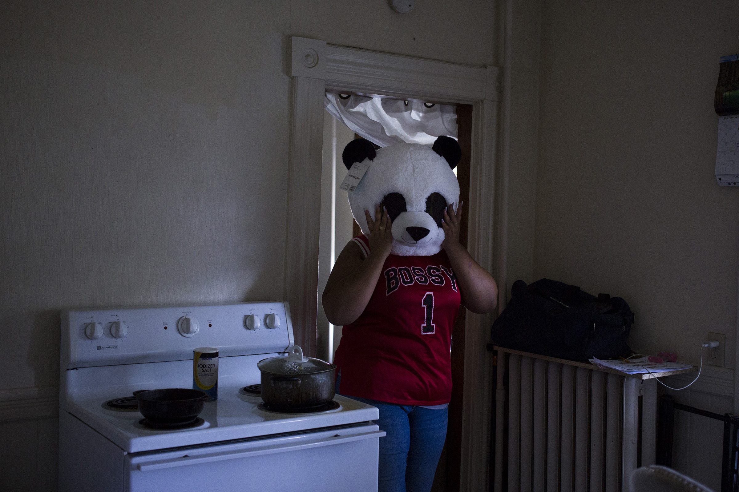 Destiny Montez, 17, shows her panda bear costume in the kitchen of her home in Springfield, Mass., on Saturday, September, 9, 2017. (Photo by Brittany Greeson)