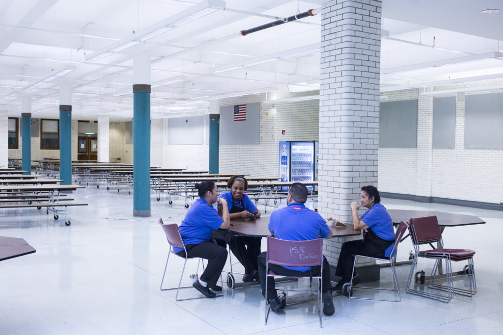 Selina Torres, center, talks with other cafeteria staff members during a break before lunch is served at the High School of Commerce in Springfield, Mass., on Monday, September, 11, 2017. (Photo by Brittany Greeson)