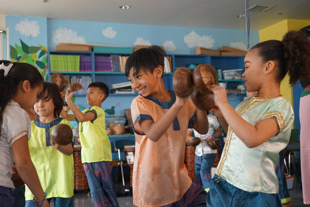 Irish American music teacher Rita Laughlin teaches kids in Lowell, Massachusetts, how to play traditional Cambodian instruments. Here, fourth graders practice the Coconut Dance in costume. (Photo by Heidi Shin)
