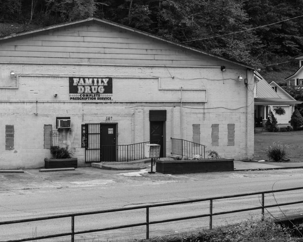 A pharmacy is one of the few remaining businesses in the former coal camp of Wheelwright, Ky. (Photo by Ben Brody)