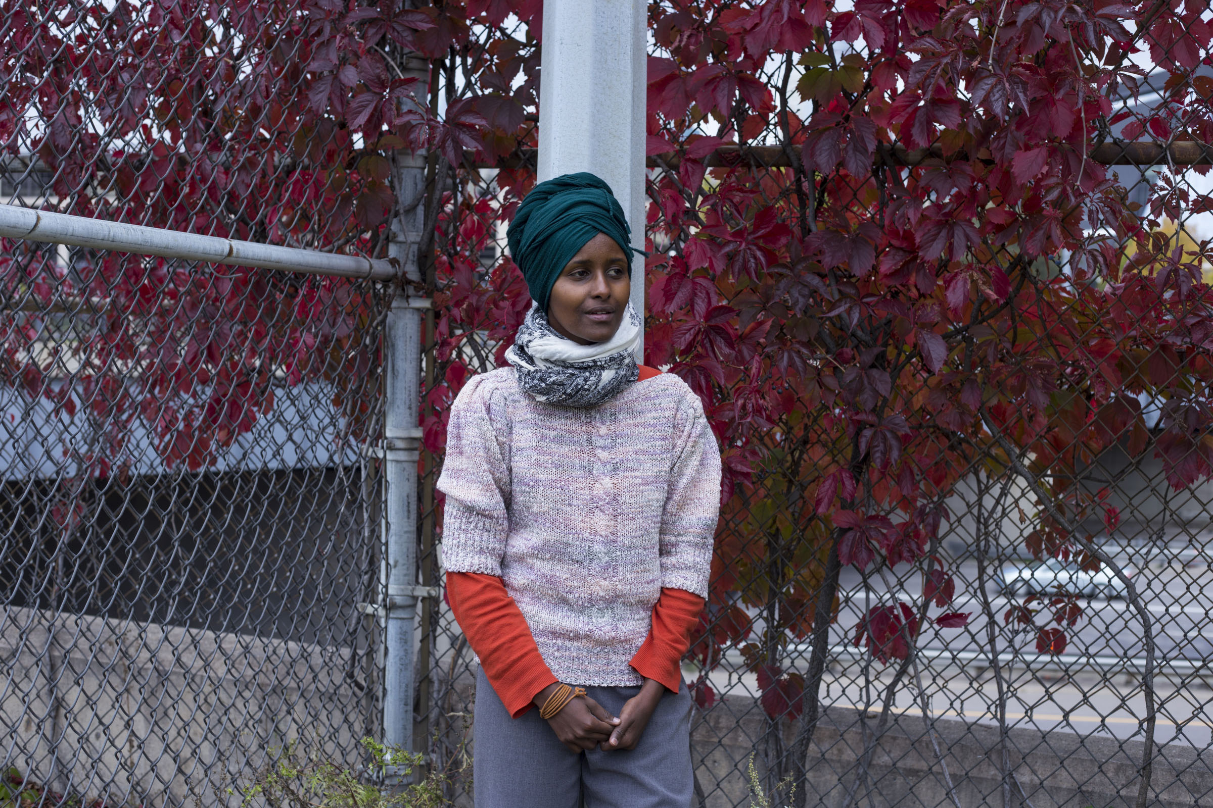 Multimedia and performance artist Ifrah Mansour, 30, outside of the Brian Coyle Center in the Cedar-Riverside neighborhood of Minneapolis, Minn., on Monday, October 9, 2017. (Photo by Brittany Greeson)