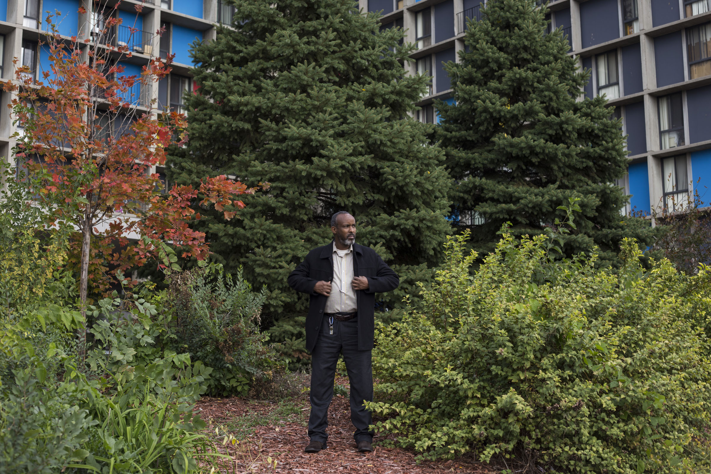 Abdirisaq Abdulle, 42, outside of his apartment building in the Cedar-Riverside neighborhood of Minneapolis, Minn., on Thursday, October 12, 2017. Abdulle, who immigrated to the United States before his children were born, said there was a generational divide between he and his children regarding Donald Trump. His kids, who he said identify more as American, liked the president, while he thinks Trump's rhetoric was anti-Muslim and often false. (Photo by Brittany Greeson)