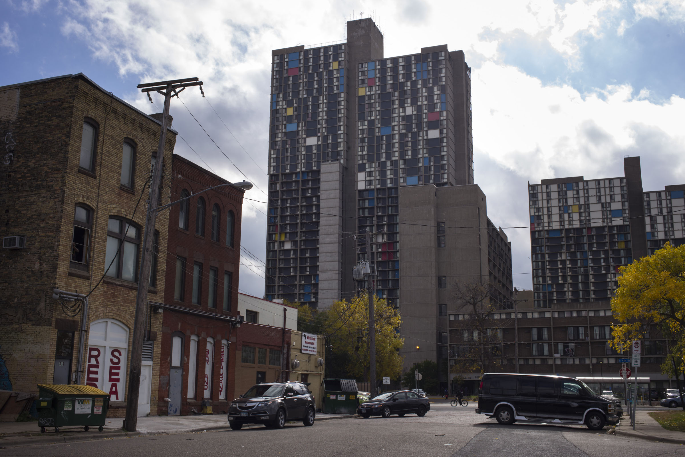 An apartment building towers over shops in the Cedar-Riverside neighborhood of Minneapolis, Minn., on Thursday, October 12, 2017. (Photo by Brittany Greeson)